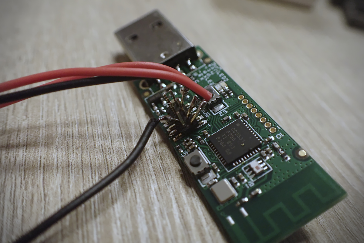 Debug pins on the Zigbee dongle with wires attached